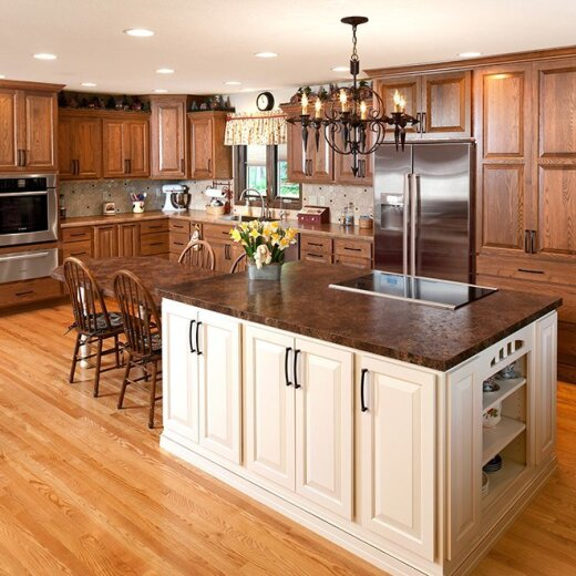Light brown kitchen cabinets with island