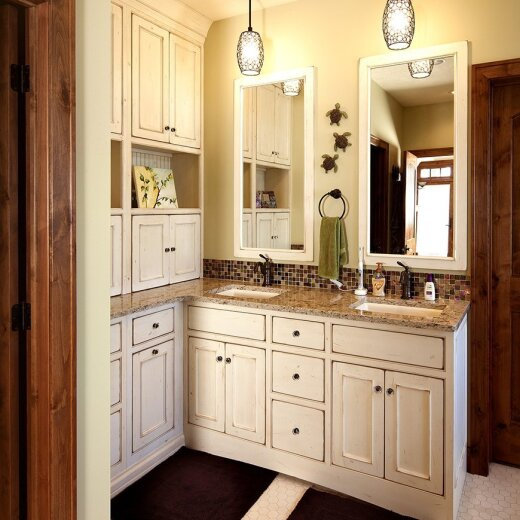 White cabinets with marble top in bathroom