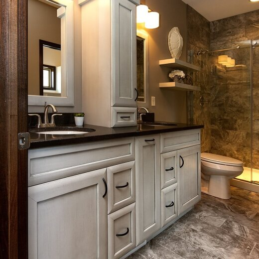 White bathroom cabinets with black top